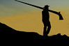 Nendaz  : Silhouette of man carrying an alpine horn in the mountains as the sun is setting<br /> Festival Cors des alpes