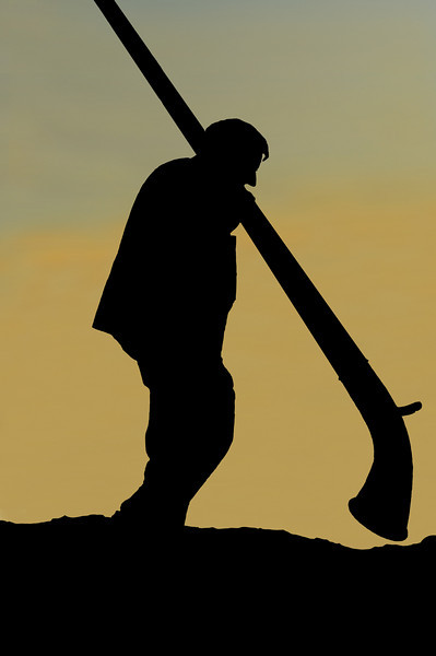 Nendaz : silhouette of man carrying an alpine hornat sunset<br /> Festival Cors des alpes