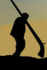 Nendaz : silhouette of man carrying an alpine hornat sunset<br /> Festival Cors des alpes