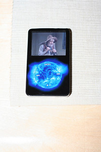 30gb Black iPod Video (5G) with Decalgirl skin and Agent18 case.