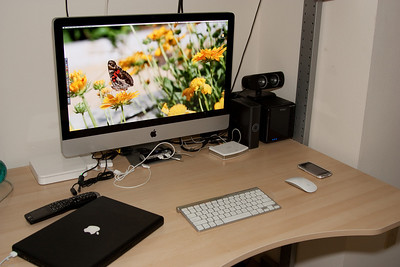 "27"" iMac (replaces the 24"").  Airport Extreme base station on the left.  Drobo on the right."