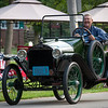 Isn't this guy having fun in his1914 Trumull horseless carriage?