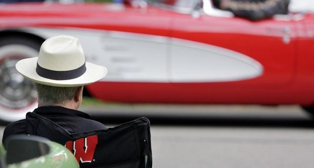 Mike MacGregor of Appleton wears a hat as stylish as the Corvette he watches arrive at the Appleton Old Car Show and Swap Meet at Pierce Park in Appleton, Wisconsin on Sunday, July 21, 2013. Ron Page/Post-Crescent Media