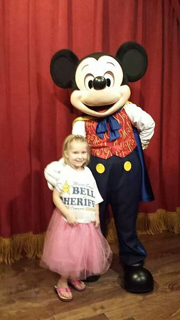 Caitlin with Mickey Mouse at Disney.<br /> <br /> Photographer's Name: Daphne Holtzleiter<br /> Photographer's City and State: Anderson, Ind.