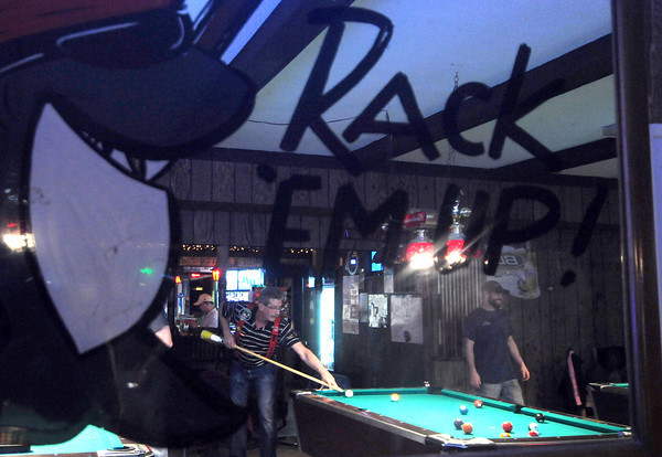 Abate of Illinois Crossroads Chapter program manager Leslie Shadell eyes a shot during Abate's broomstick pool tournament Saturday afternoon at Ichabod's in Effingham. Funds raised are going to the Lake Land College Scholarship Fund.