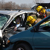 Firefighters work to extricate Jordan Probst from a crashed van at the mock car crash at Neoga High School.
