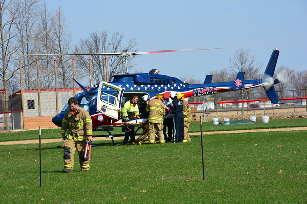 Neoga Firefighters and EMS load one of the student actors onto an airlift helicopter at the mock crash.