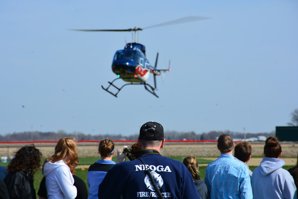 A helicopter arrives as part of a mock car crash at Neoga High School on April 10.