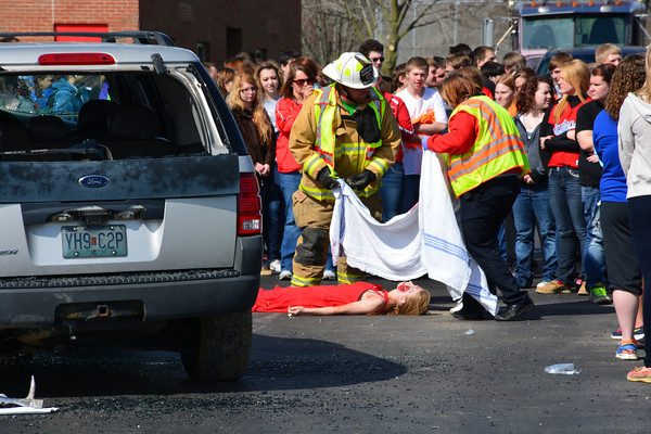 "Firefighters and EMS cover Morgan Partlow after she was ""declared dead"" at the mock crash."
