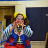 Skeeter the Clown plays a recorder and slide whistle at Sigel St. Michael School Monday.