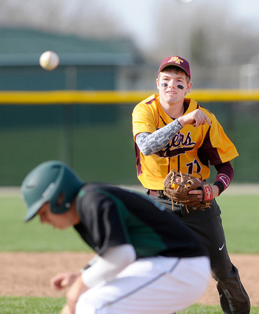 Don Knight | The Herald Bulletin<br /> Alexandria's Drew Johnson throws to first as Pendleton Heights' Thomas Hall is caught in a run down after trying to steal second. The distraction allowed Devon Bretz to steal home from third.