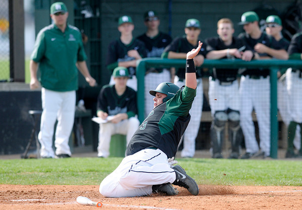 Don Knight | The Herald Bulletin<br /> Pendleton Heights' Hunter Cook slides into home to put the Arabians up 1-0 as they hosted Alexandria during the Nick Muller Tournament on Thursday.