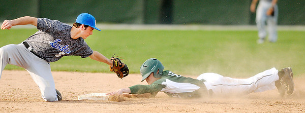 Don Knight | The Herald Bulletin<br /> Pendleton Heights' Devon Bretz slides under the tag of Heritage Christians' Andy Hunt on Thursday.