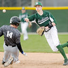 Don Knight | The Herald Bulletin<br /> Pendleton Heights short stop Justin Kirkpatrick throws to first to complete a double play after forcing Heritage Christian's Brock Grinstead out at second on Thursday.