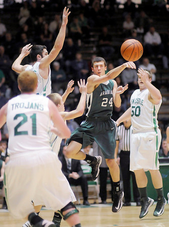 Surrounded by New Castle defenders Pendleton Heights' Brogan Gary passes the ball during the sectional final at New Castle on Saturday.