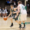 Pendleton Heights' Sean McDermott drives as he is guarded by New Castles' Kyle Goosby during the sectional final at New Castle on Saturday.