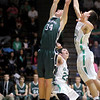 Pendleton Heights' Kurt Talbert grabs an offensive rebound during the sectional final at New Castle on Saturday.