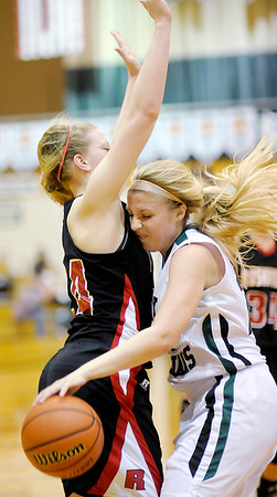 Pendleton Heights' Kenzie Gustin runs into Rushville's  Keragan Niehoff as the Arabians hosted the Lions on Saturday.
