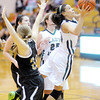 Don Knight / The Herald Bulletin<br /> Pendleton Heights Kiawna Cottrell draws a foul from Noblesville's Brooke Herron as she scores a basket for the Arabians on Wednesday.