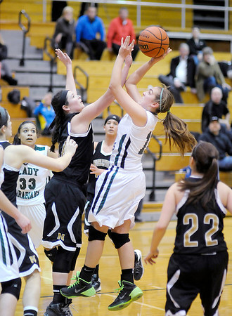 Don Knight / The Herald Bulletin<br /> Pendleton Heights Sue Hammel shoots as she is guarded by Noblesville's Katelyn O'Reilly on Wednesday.