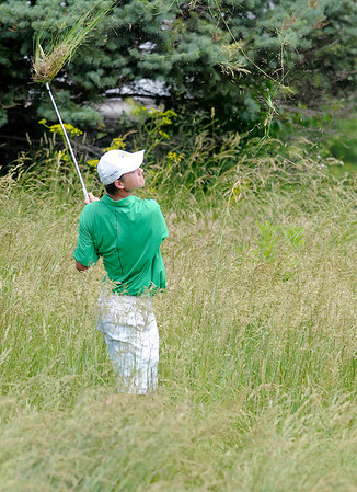 Colin Proctor shoots from the rough on the 17th hole.