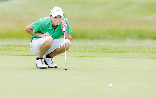Tyler Meyer reads the break of his putt on the eighth green.