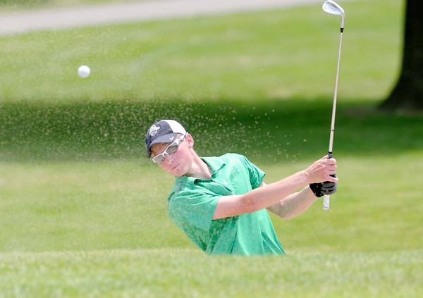 Trevar Denney hits out of a bunker onto the eighth green.