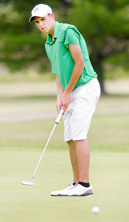Tyler Meyer putts on the ninth green.