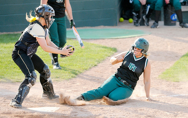 Don Knight | The Herald Bulletin<br /> Pendleton Heights' Jordan Dean beats the tag of Mt. Vernon catcher Kylie Lyons to put the Arabians up 6-0 in the bottom of the fifth on Thursday.