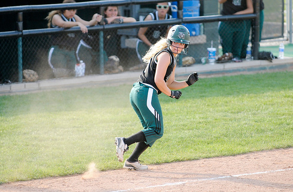 Don Knight   The Herald Bulletin<br /> Pendleton Heights' Sydney Windlan heads back to third as the Arabians hosted Mt. Vernon on Thursday.