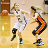 Pendleton Heights' Skyla Baird looks to pass the ball as she is guarded by Hamilton Heights' Haley Cook as the Arabians hosted the Huskies on Wednesday.