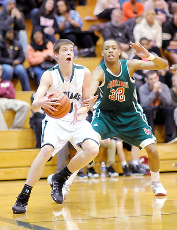 Don Knight / The Herald Bulletin<br /> Pendleton Heights Sean McDermott drives the baseline as the Arabians hosted Lawrence North on Wednesday.