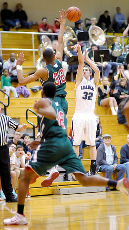 Don Knight / The Herald Bulletin<br /> Pendleton Heights' Kenton Dunham shoots from three-point range as he is guarded by Lawrence North's Perry Poindexter Jr. on Wednesday.
