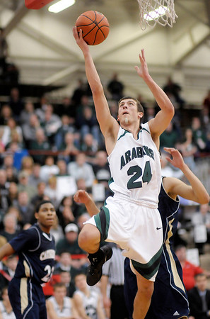 Pendleton Heights' Brogan Gary scores a layup as the Arabians faced Cathedral in regional basketball action at Southport High School on Saturday.