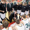 Pendleton Heights coach Brian Hahn talks to his team before the Arabians faced Cathedral in regional basketball action at Southport High School on Saturday.