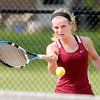 Don Knight | The Herald Bulletin<br /> Alexandria's Abbie Miller returns a volley to Pendleton Heights' Emma McCardwell  during the number one singles match as the Tigers hosted the Arabians during the first round of the sectional on Wednesday.