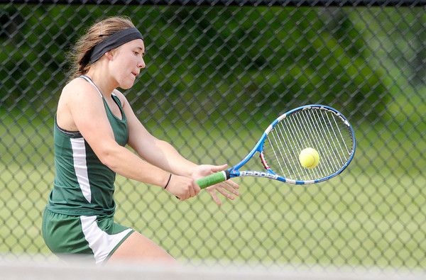 Don Knight | The Herald Bulletin<br /> Pendleton Heights' Emma McCardwell returns a volley to Alexandria's Abbie Miller during the number one singles match as the Tigers hosted the Arabians during the first round of the sectional on Wednesday.