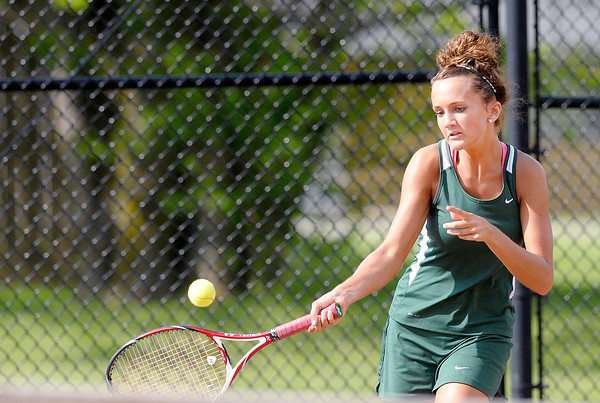 Don Knight | The Herald Bulletin<br /> Pendleton Heights' Carly Wilson returns a volley to Alexandria's Hannah Libler during the number two singles match as the Tigers hosted the Arabians during the first round of the sectional on Wednesday.