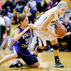 Pendleton Heights' Kenzie Gustin steals the ball away from Muncie Central's Kristi Rhodes on Saturday.