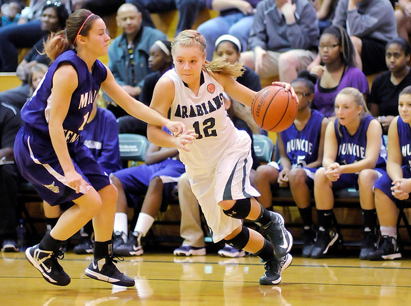 Pendleton Heights' Tiffany Wertz drives against Muncie Central's Madelyn Beaver on Saturday.