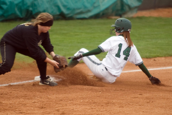 Pendleton Heights' Sarah Dixon slides safely into third base under the tag. Pendleton Heights beat Lapel in the 2013 Madison County Softball Tournament Friday, April 12, 2013. Photo by Richard Sitler