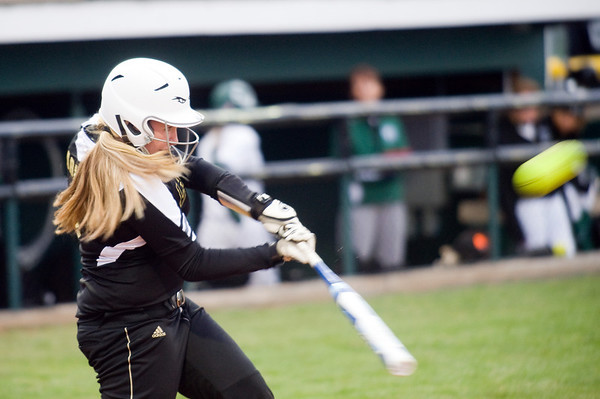 McKalyn Weeks hits a home run for Lapel in the sixth inning. Pendleton Heights beat Lapel in the 2013 Madison County Softball Tournament Friday, April 12, 2013. Photo by Richard Sitler