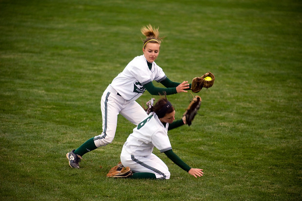 Breanna Pryor (left) and Delilah Wright collide while fielding a ball. Wright was able to make the catch despite the collision. Pendleton Heights beat Lapel in the 2013 Madison County Softball Tournament Friday, April 12, 2013. Photo by Richard Sitler