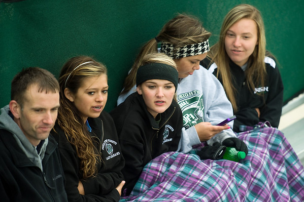 Pendleton Heights fans are bundled up and sit under a blanket to stay warm as they watch the Pendleton Heights play Lapel in the 2013 Madison County Softball Tournament Friday, April 12, 2013. Photo by Richard Sitler