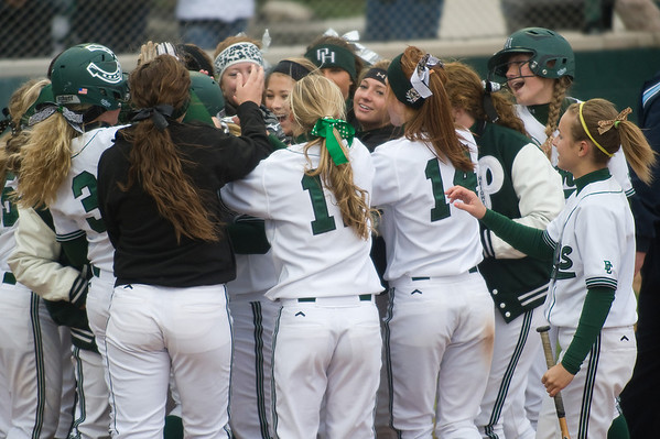 Pendleton Heights celebrate a home run by Elizabeth Sigler in the second inning. Pendleton Heights beat Lapel in the 2013 Madison County Softball Tournament Friday, April 12, 2013. Photo by Richard Sitler