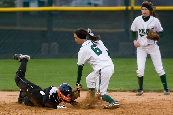 Pendleton Heights' Breanna Pryor attempts to tag a Lapel base runner who was tagging up at second after a caught fly ball in the sixth inning. Pendleton Heights beat Lapel in the 2013 Madison County Softball Tournament Friday, April 12, 2013. Photo by Richard Sitler