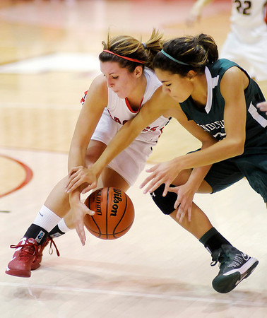 Frankton's Katie Key and Pendleton Heights' Kiawana Cottrell scramble for a loose ball as the Eagles hosted the Arabians on Saturday.