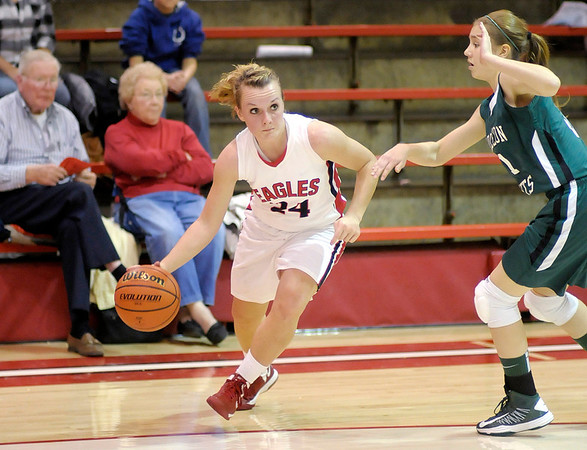 Frankton's Natalie McGuire drives to the basket as she is guarded by Pendleton Heights' Skyla Baird as the Eagles hosted the Arabians on Saturday.