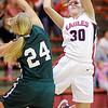Frankton's Kelsey Key shoots as she is guarded by Pendleton Heights' Kenzie Gustin as the Eagles hosted the Arabians on Saturday.