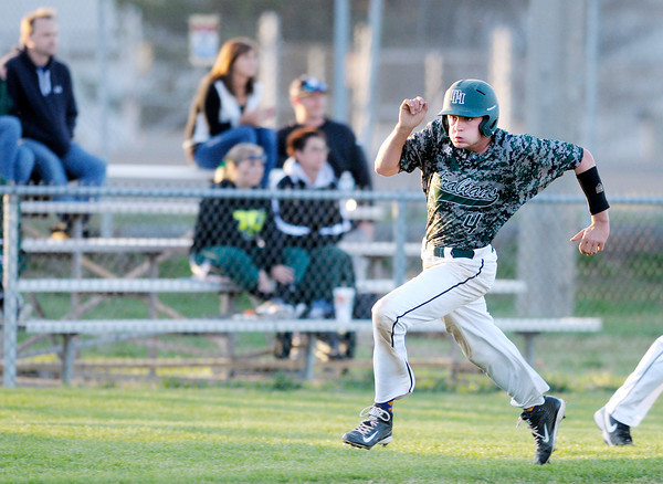 Don Knight | The Herald Bulletin<br /> Pendleton Heights' Austin MacMillan rounds third headed for home during the Nick Muller Memorial Baseball Tournament championship on Saturday at Memorial Field.